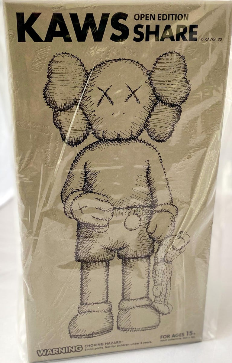 KAWS SHARE (Brown), new & unopened in its original packaging.   Medium: Painted Vinyl Cast Resin.  12.4 x 6.3 inches.  New, unopened in its original box; excellent condition.   From a sold out edition of unknown. Stamped to the underside of foot.