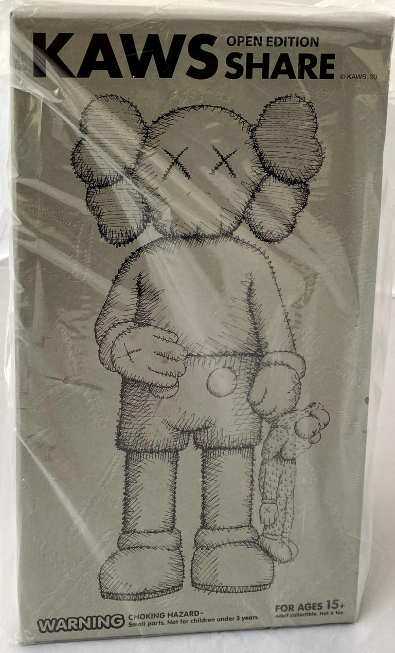 KAWS SHARE (Grey), new & unopened in its original packaging.   Medium: Painted Vinyl Cast Resin.  12.4 x 6.3 inches.  New, unopened in its original box; excellent condition.   From a sold out edition of unknown. Stamped on the underside of foot.