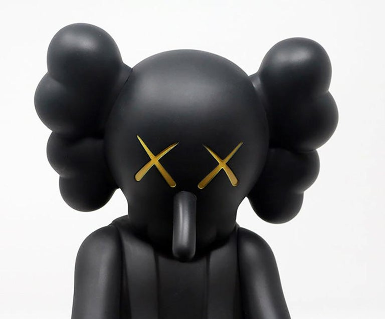 KAWS  Small Lie Companion figure 2017   Medium: Vinyl figurine. Color: Black.  Dimensions: 11 × 4.5 × 4.5 inches  Unopened; excellent condition  Published by Medicom Japan. From an unnumbered edition of unknown  Stamped in underside of feet.