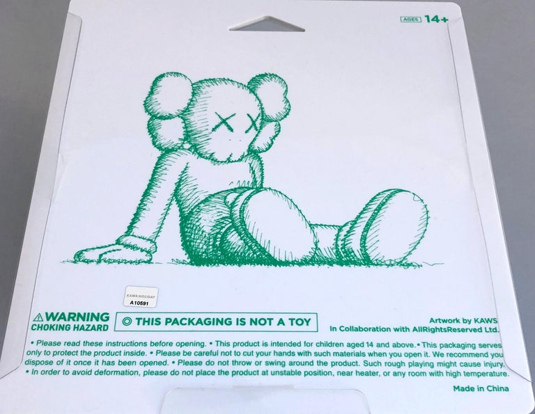 KAWS Brown Holiday Companion (KAWS Taipei)  This figurine features KAWS' signature character COMPANION in a resting seated position. The piece was published by All Rights Reserved to commemorate the debut of KAWS' largest sculptural endeavor to