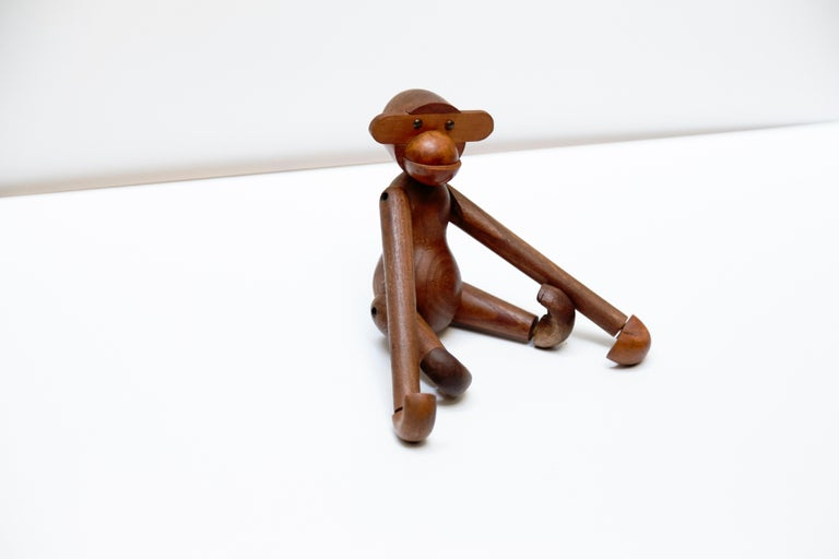 Early Edition of the teak wood monkey designed by Kay Bojensen. Manufactured in Denmark circa 1960.  In good original condition with wear consistent of age and use, preserving a really beautiful patina.  Measurements:  20 cm H x 18 cm W x 5