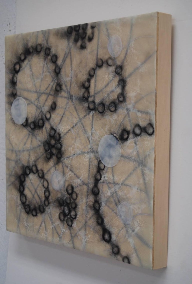 """Kay Hartung's """"Cell Pathways 1"""" is an imagined scene of cell activity which creates a sense of the energy involved in the process of growth. In a limited palette of black and white, lines divide the background as circles float on the surface. A lace"""