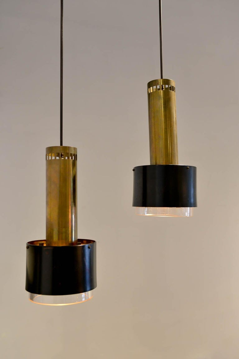 Kay Korbing for Lyfa Denmark pendant lights, circa 1960. Newly rewired to UL standards. Made of enameled steel, brass and glass in good vintage condition.  Measures: 13.25