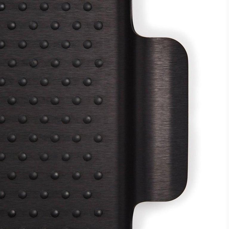 Anodized aluminium, silicone rubber grip.  Measures: 14