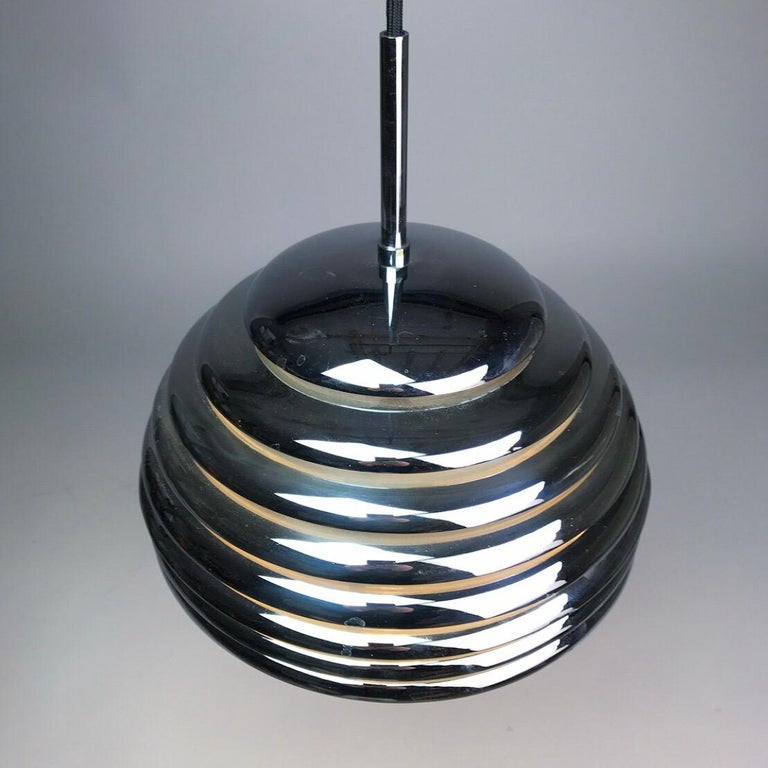Beautiful Saturno chrome ceiling light by Kazuo Motozawa for Staff Leuchten, Germany 1970s.   This contemporary designed ceiling light consists of eight chrome-plated rings with white lacquer to the inside.   Stunning condition without any chips