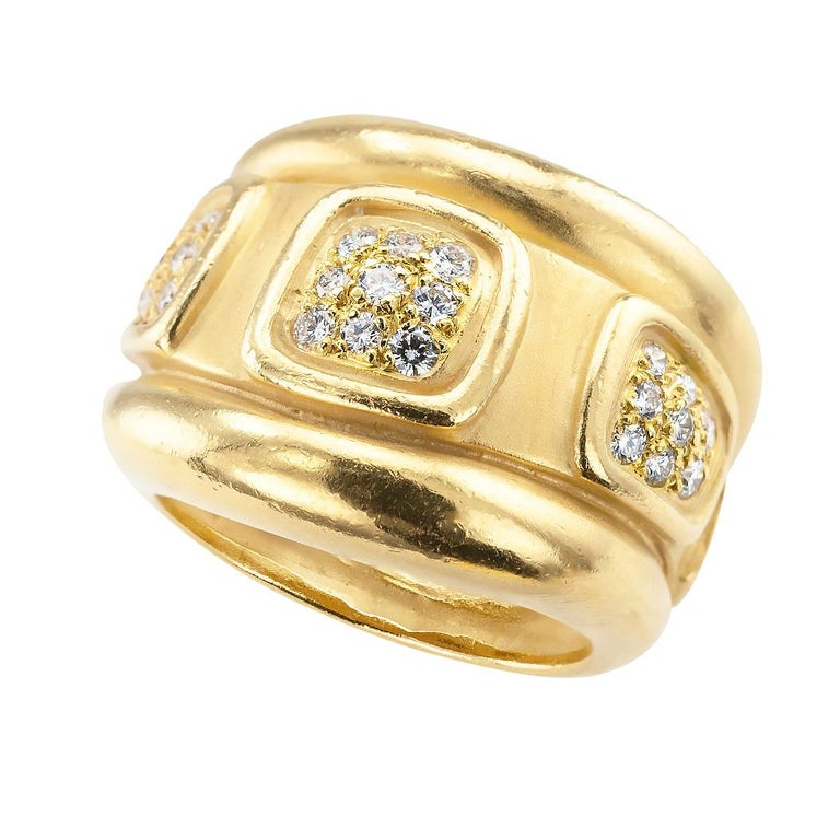 Keiselstein Cord diamond and yellow gold wide ring band circa 1997.  DETAILS:  DIAMONDS:  twenty-nine round brilliant-cut diamonds totaling approximately 0.50 carat, approximately G – H color, VS clarity.  METAL:  18-karat yellow gold.  WEIGHT: