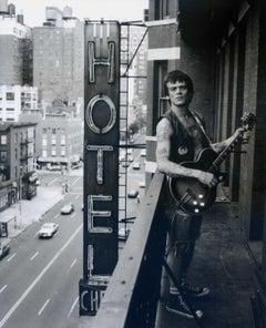 Dee Dee Ramone on Balcony with Guitar
