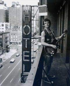 Dee Dee Ramone on Balcony with Guitar