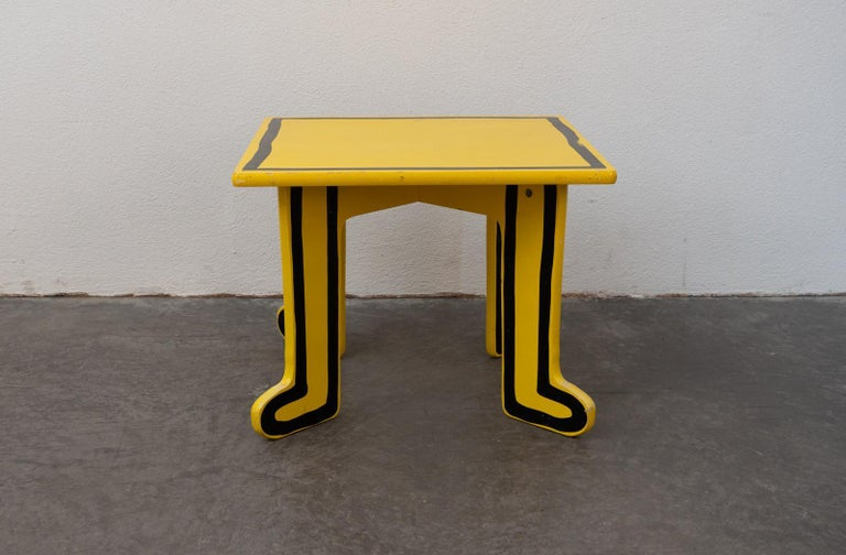 Quirky yellow kids table made by Vilac France 2000s designed by Keith Haring (USA 1958–1990).