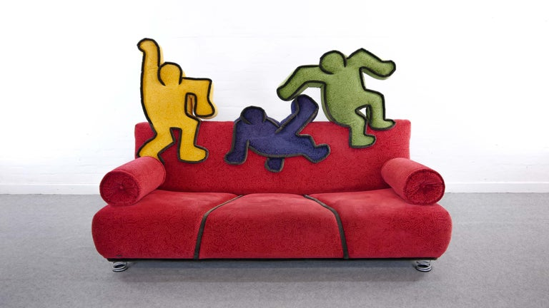 Pop Art Design. Keith Haring 3-seat sofa for Bretz, Designed in colaboration with the Haring Foundation 2002, Pop - Art Design, Original upholstery in red velvet-like fabric with small Haring motives. Backrest with 3 classical Haring figures in