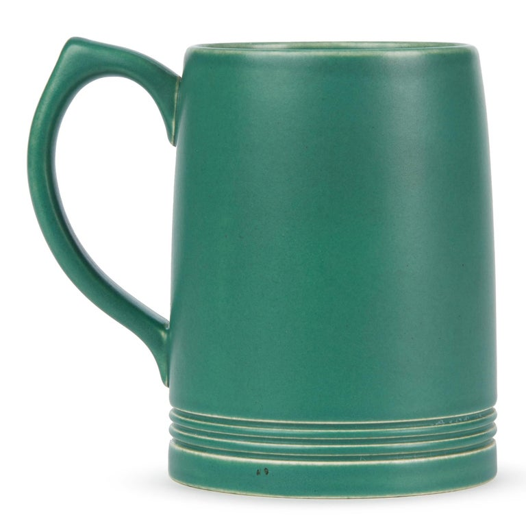 A good iconic Art Deco Wedgwood green glazed pottery mug designed by Keith Murray and dating from circa 1935. The mug has an incised signature mark to the base. Offered in excellent condition.