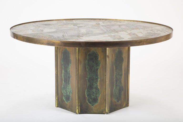 A beautiful coffee table depicting Asian figures by Kelvin and Phillip Laverne.