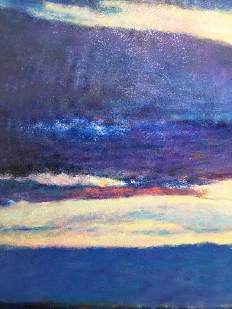 'Blue Skyscape' 2011 by American artist, Ken Elliott. Oil on canvas, 36 x 60 in. This painting of clouds and sky is primarily monochromatic. Comprising of the color blue in varying hues, the painting moves from left to right. The sun reflected