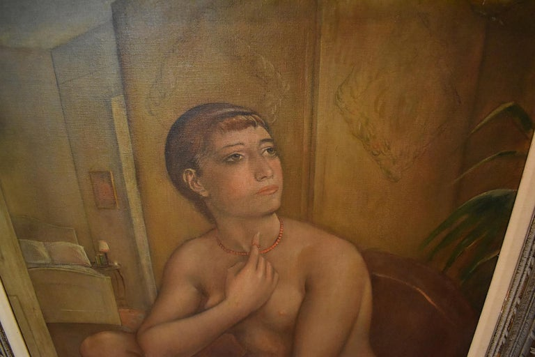Kenneth Hayes Miller paints his iconic wide eye female sitting nude in a traditional formal pose. Her left leg is partially draped. She looks up and out pondering. Her index finger penetrates a circular loop formed in her orange coral necklace. In