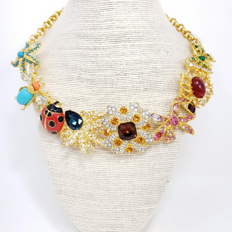Kaleidoscope necklace by Kenneth Jay Lane. Signature KJL designs linked together to form a dazzling statement necklace! Colorful starfish, fly, ladybug, butterfly, jelly belly spider, flower, and leaf motifs.  Features faux pearls, painted enamel,