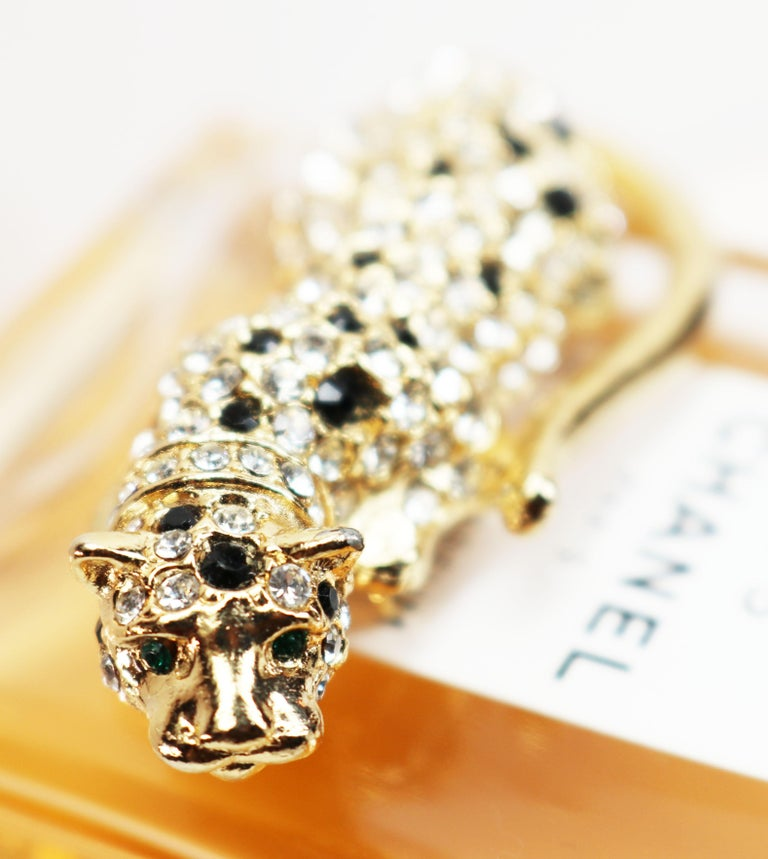 1960s Kenneth Jay Lane *signed* Rare Black and Clear Austrian Crystal Gold Plated Green Eyed Leopard Fur Clip  This KJL leopard fur clip is an exotic and absolutely breathtaking piece with the leopard in a playful, pouncing pose! The pave rhinestone