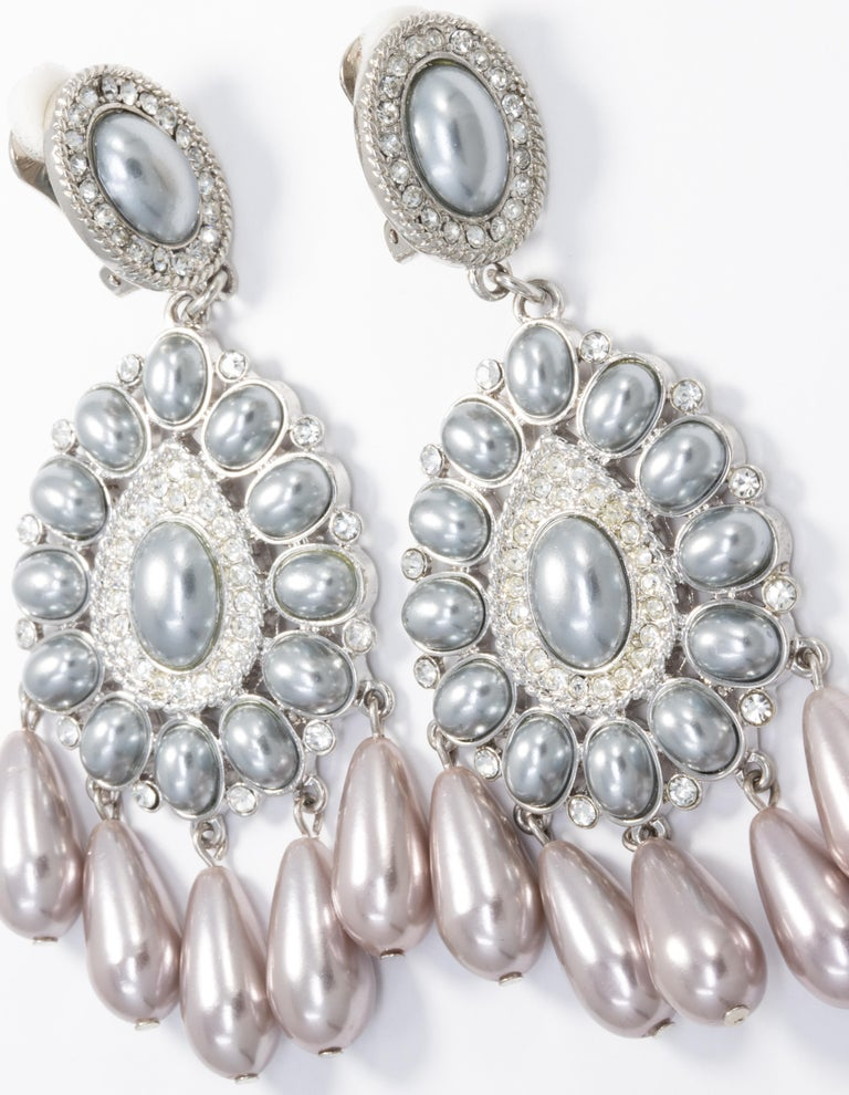 These circle-drop clip-on earrings feature metallic gray cabochons and crystals for a big and bold look!  By Kenneth Jay Lane.  Hallmarks: KJL, China