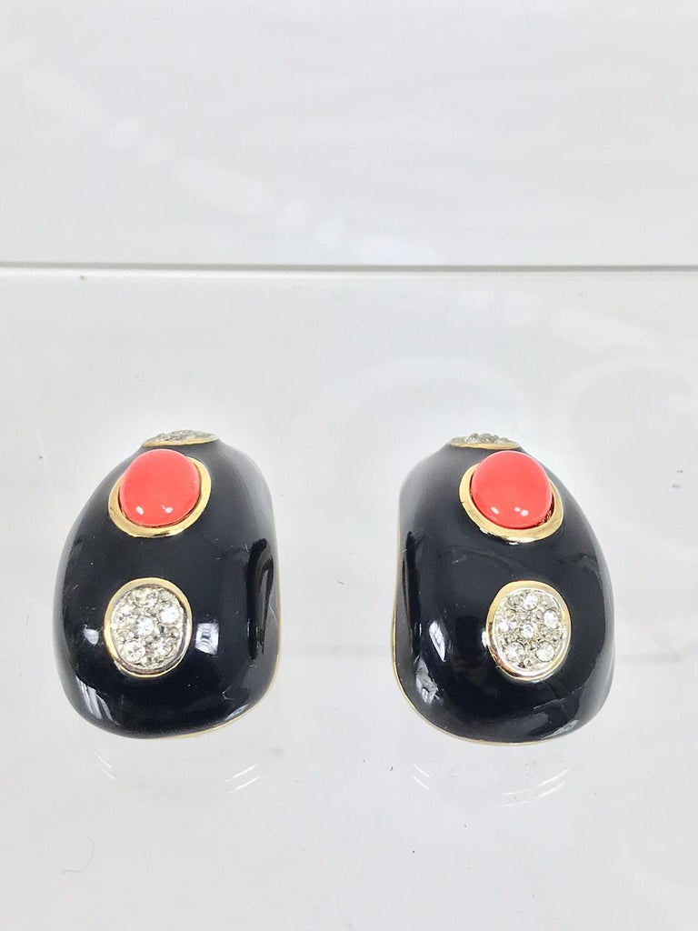 Kenneth Lane black enamel faux coral and rhinestone earrings from the 1990s. These chunky earrings are show stoppers, they look amazing on and they are in excellent condition. Measurements are in inches: 1 1/2 high 1 wide at the bottom.   .