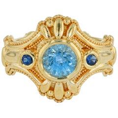 Kent Raible 18 karat Gold Aquamarine Blue Sapphire Three-Stone Ring, Granulation