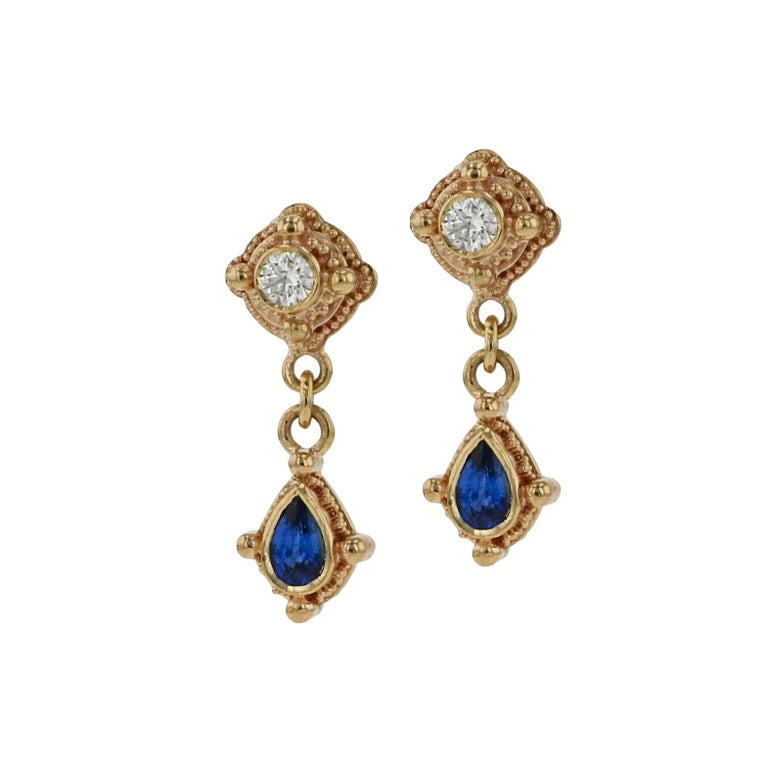 Kent Raible's take on the classic look of Diamonds and Blue Sapphire is simplicity with style! Framed in his 18 karat gold, Raible's granulation and elegant detailing make these drop earrings perfect for day or evening.  Heavy 18karat gold earring
