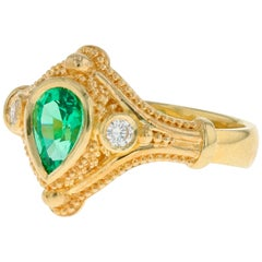 Kent Raible 18 Karat Gold Emerald and Diamond Three-Stone Ring with Granulation