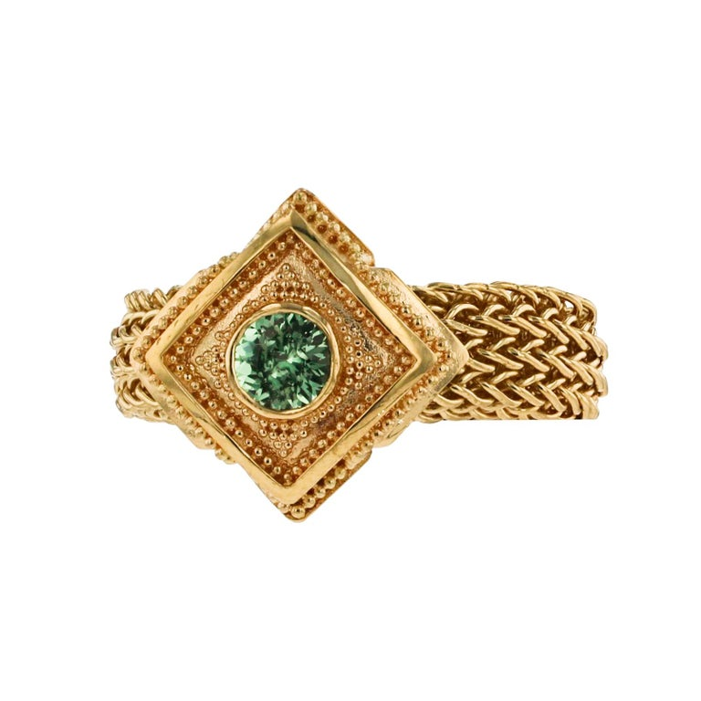 A unique ring from the Kent Raible 'Studio Collection'! This ring features the Raible classic gold granulation, but uses a flexible mesh, hand woven chain band! The soft Green Grossular Garnet adds a wonderful sparkle to this unique design. Do you