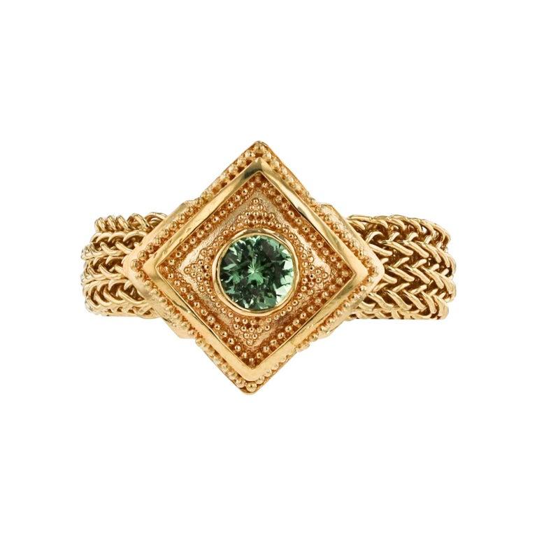 Kent Raible 18 Karat Gold Green Garnet Fashion Ring with Woven Chain For Sale