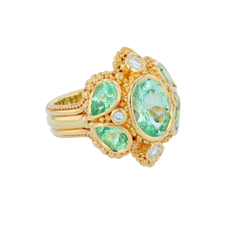 Kent Raible's Bespoke Green Grossular Garnet Cocktail Ring is full of amazing sparkle! Green Grossular Garnets have a refractive index close to that of Diamond which give them a dazzling effect. To take that effect up another notch, 4 white Diamond