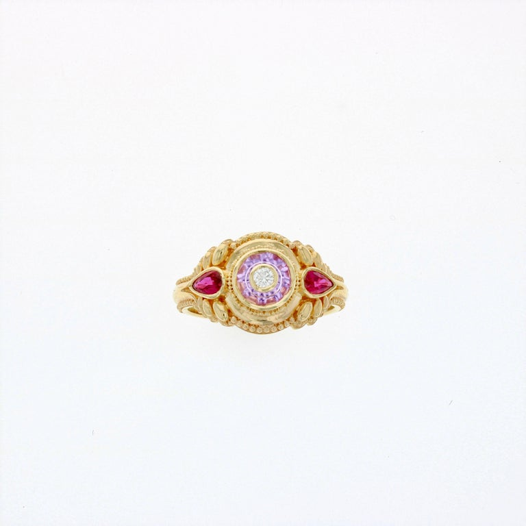 Master Goldsmith Kent Raible's one of a kind ring has been hand fabricated in 18 karat gold with elegant detailing and fine granulation.   The Pink Sapphire has been cut by master gem carver Glenn Lehrer. This is Glenn's patented 'Torus Ring' cut,