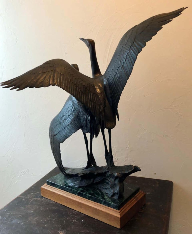 This piece is signed and numbered 24/24.  A larger version of this sculpture is on display at the Woodson Art Museum. Kent Ullberg has works in many major museum, public, and. corporate collections. This sculpture is from a sold out edition.