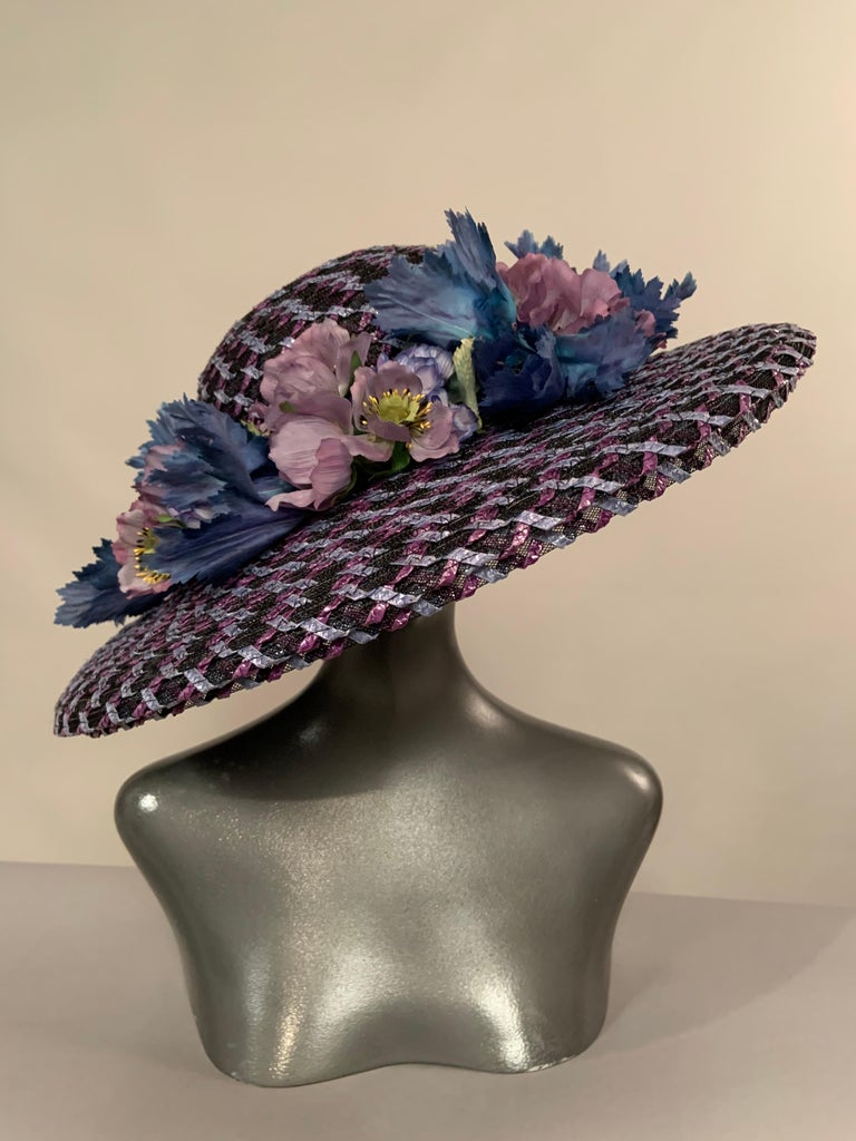 My client wore this hat to the 2004 Kentucky Derby as a guest of the owners of Smarty Jones.  Smarty Jones won the Kentucky Derby that day, and I think this just might be a lucky hat!   It is mad from woven black, violet and blue straw on a base of