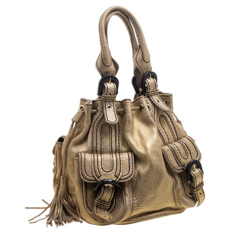 6004214b14a Kenzo Gold Leather Drawstring Studded Bucket Bag In Good Condition For Sale  In Dubai, Al