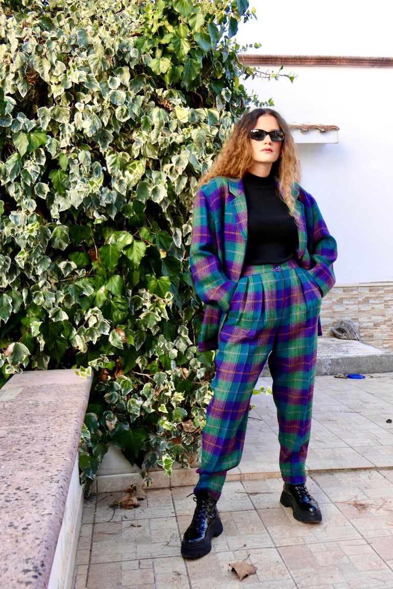 Kenzo 80s vintage woman's dress wool check. Pants suit with jacket and plaid trousers with purple squares green. The dress is fully lined. Composition 100% wool. Classic 80's comfortable fit jacket, trousers with adjustable waist, low crotch. Made
