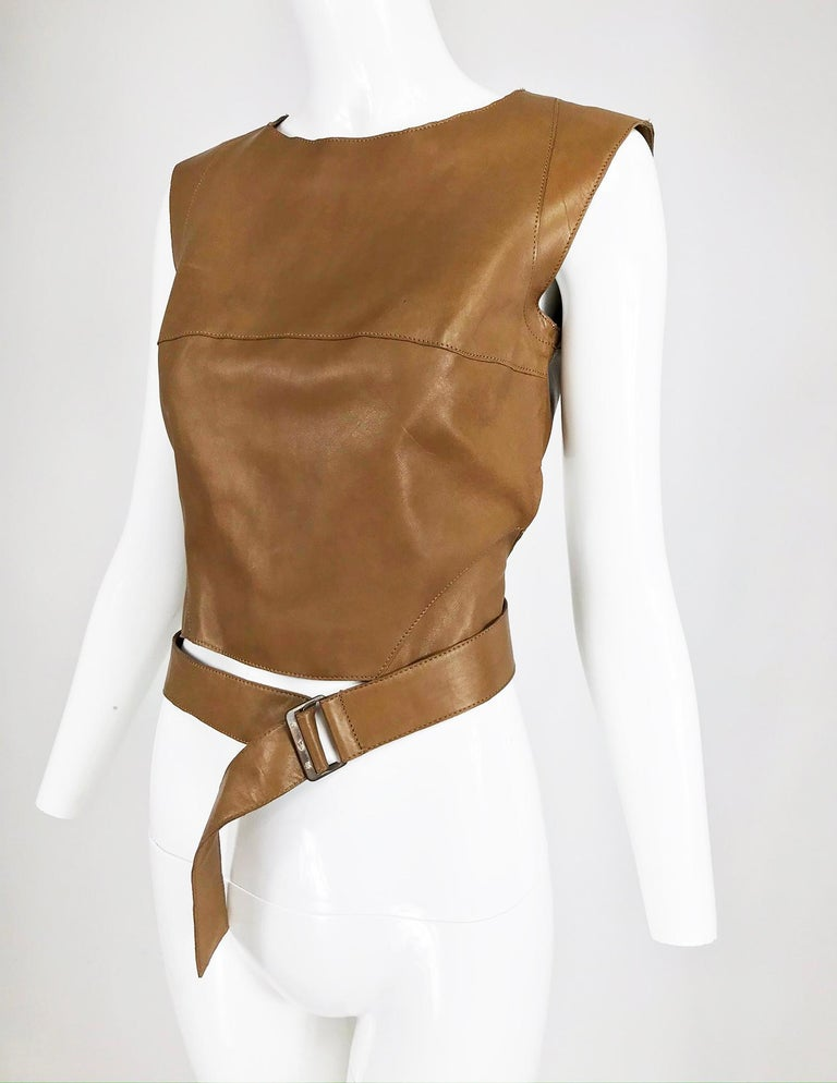 Kenzo Jungle soft caramel leather waist wrap cropped top from the 1980s. This top has the original tags and looks unworn, it feels like lambskin. Sleeveless top pulls on and closes at the back with a zipper, the back is cropped high. The top front