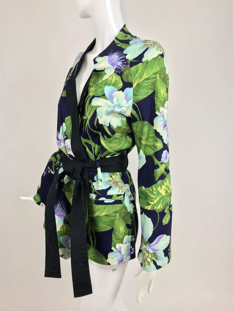 Kenzo Jungle tropical cotton print wrap jacket from the 1980s. Soft cotton jacket with long full raglan sleeves, notched collar it is hip length, wraps at the front with a matching fabric tie belt. Hip front besom pockets. The pieced lining is eye