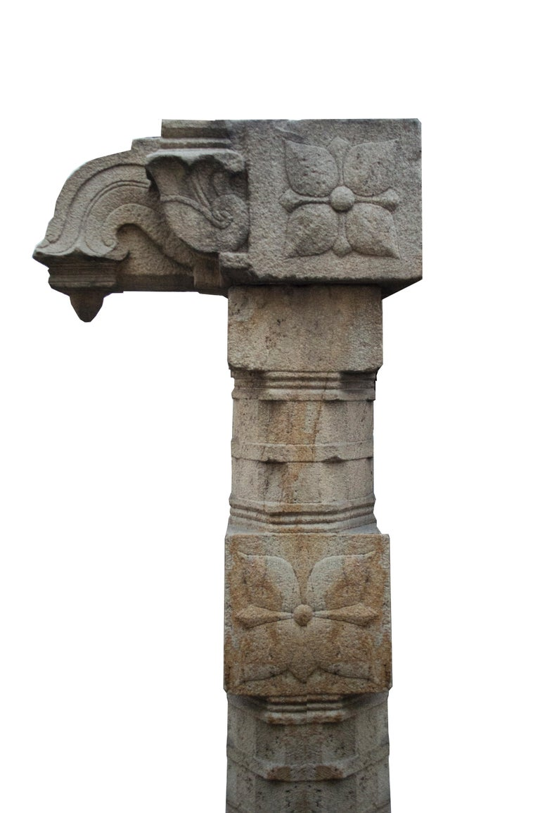 This unique monolitic reddish granite columns come from religious houses to fantastic temples in the south of the Indian subcontinent. This specific piece, with a beautiful geometric movement , has a Mandala on the center and a stilisted Naga, the