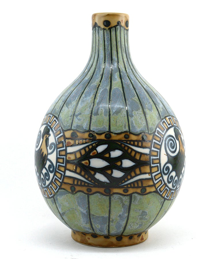 Stoneware vase made at Keramis studio (Boch Freres) directed by Charles Catteau, La Louviere, Belgium, 1920. Slip-cast form. Decoration with printed contours filled in with matte watery green and yellowish glazes (blended) and glossy beige and