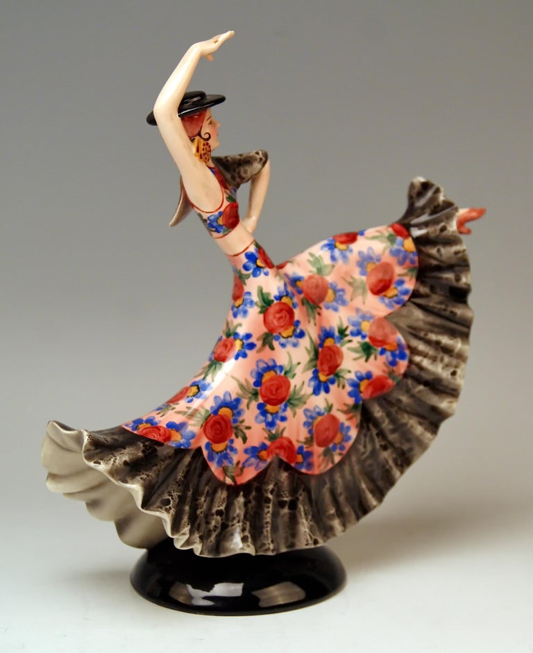 Keramos stunning Spanish lady dancer clad in typical Spanish garments. Designed by Stefan Dakon (1904–1997) / made, circa 1950-1960.  Hallmarked at reverse side: Keramos Vienna Manufactory Heraldic Mark & inscription 'MADE IN AUSTRIA' Existing /