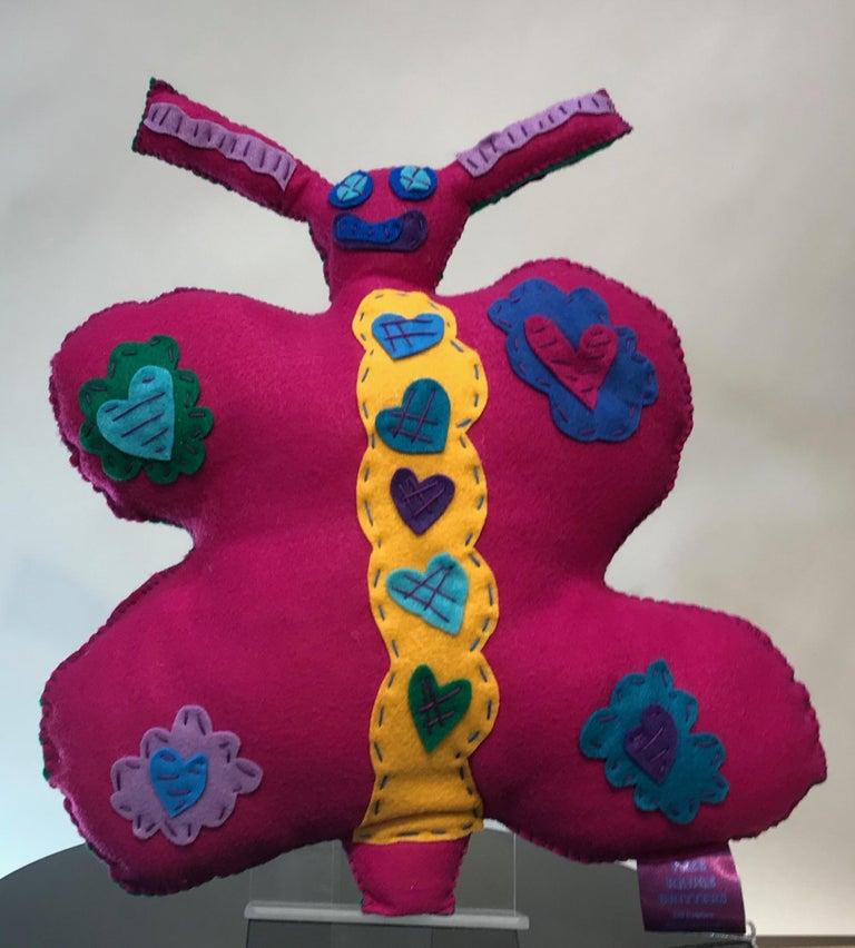 Kerry Green Figurative Sculpture - Free Range Butterfly, soft sculpture, felt, pink, green, yellow, blue, purple