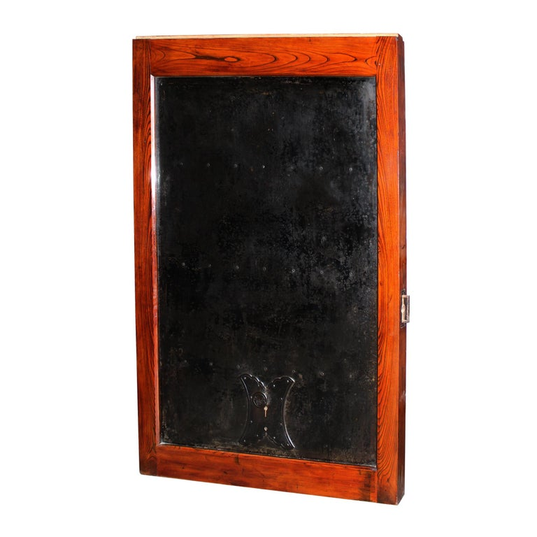 Keyaki wood warehouse door was used as the main door to a furniture warehouse in Kyoto, Japan. Keyaki wood with original metal and lockplate. Edo period, circa 1850s. Can use as the top of a large dining or coffee table with custom base or use as an