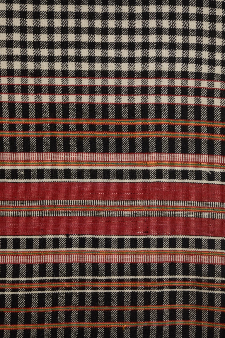 Handwoven chequered and striped wool blanket. Indian Khadi weave.