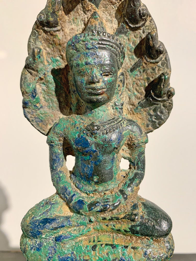 Khmer Bronze Buddha with Naga, Angkor Period, Style of the Bayon, 14th Century For Sale 7