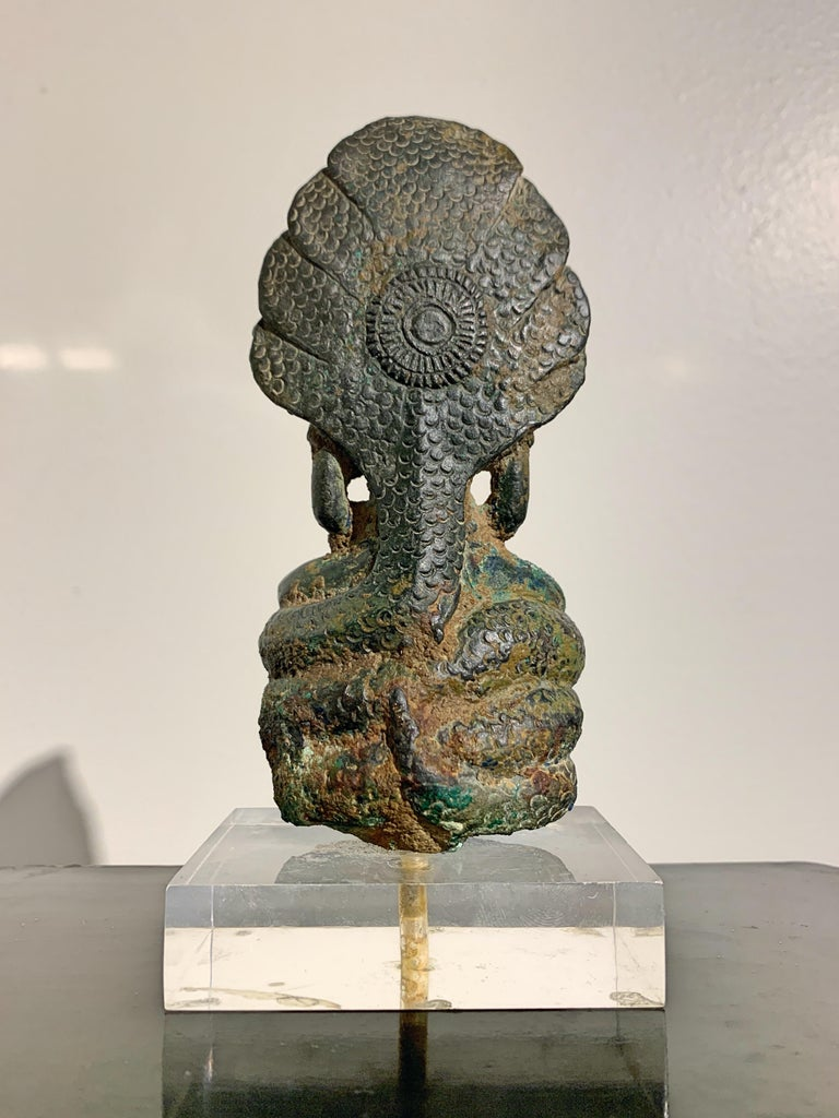 Cast Khmer Bronze Buddha with Naga, Angkor Period, Style of the Bayon, 14th Century For Sale