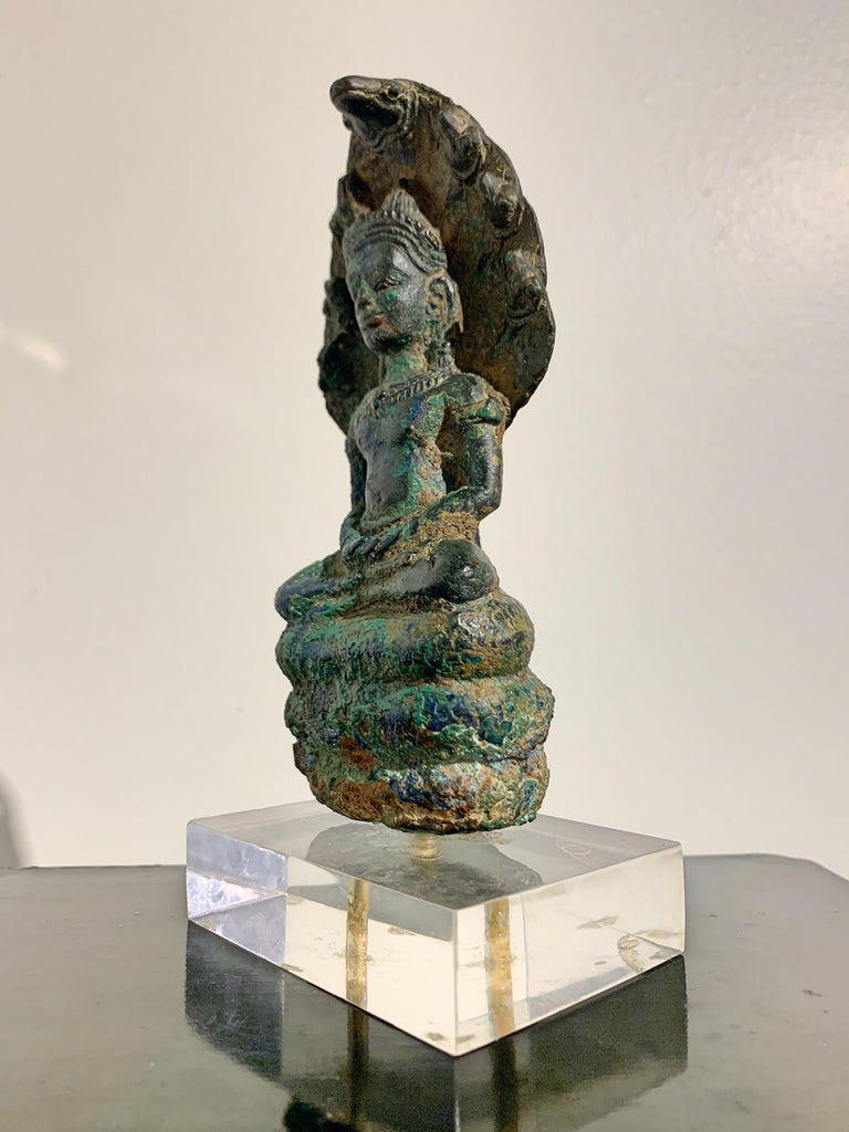 18th Century and Earlier Khmer Bronze Buddha with Naga, Angkor Period, Style of the Bayon, 14th Century For Sale