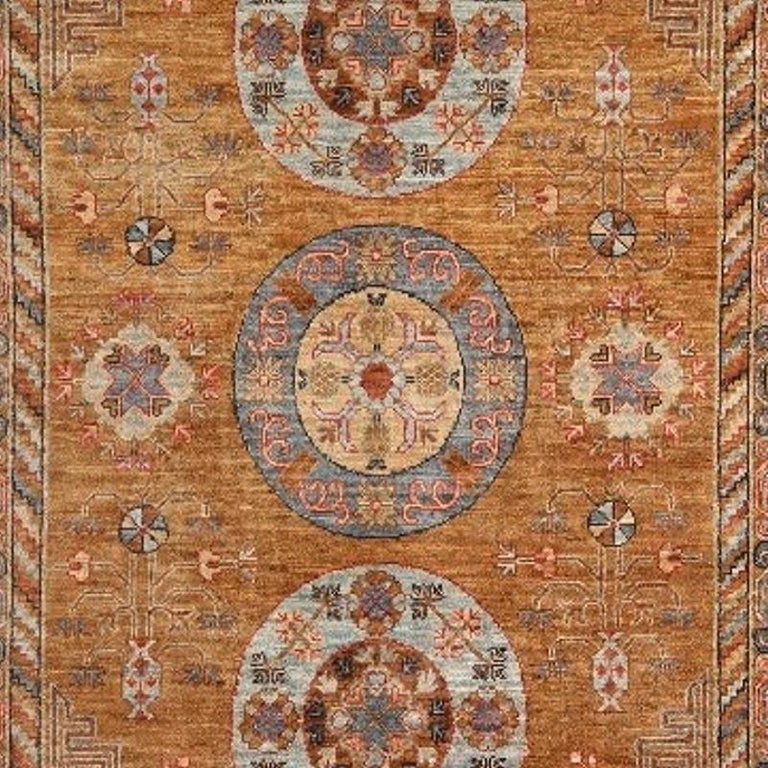 A circa 7 x 5 ft sized rug with a Khotan style design. The pile is made of high end quality wool - hand spun, hand dyed with all vegetable dyes and knotted by master weavers. The rug is very decorative and has a towards square format. The condition