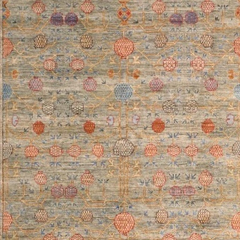 A medium sized rug with traditional Khotan style design. The pile is made of high end quality wool - hand spun, hand dyed with all vegetable dyes and knotted by master weavers. The rug is very decorative and has a towards square format. The