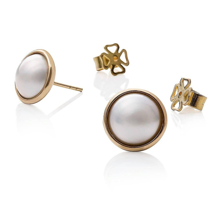 Mabe Perla Earrings  Set with a gorgeous pair of large Mabe pearls, these stud earrings are perfect for everyday wear.  Mabe pearls: high lustre, 11mm each  Weight: 5.50g