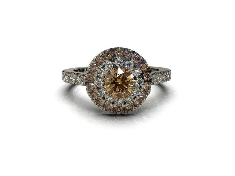 Colored Diamond Halo Ring  This stunning ring is set with an extraordinary round Champagne diamond complemented with a halo of Cognac and white diamonds. The diamonds are also set into the band. A distinctive heirloom piece.  Round brilliant cut