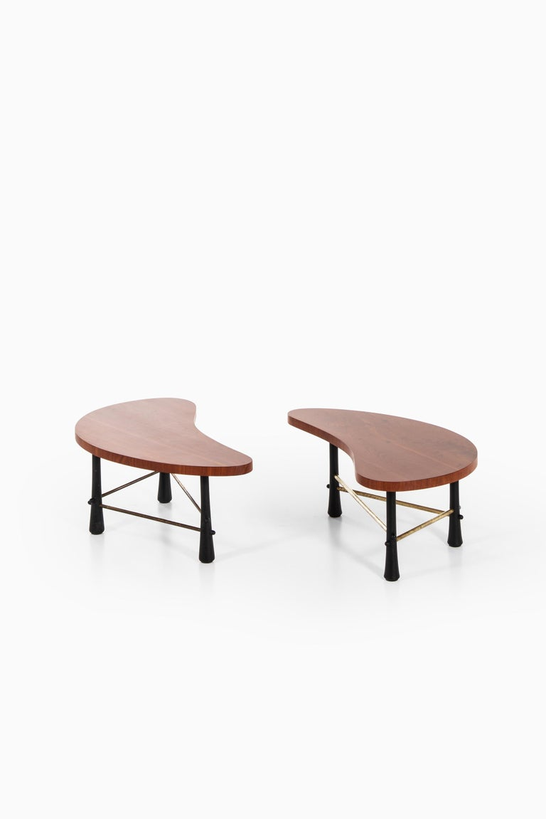 Rare kidney-shaped coffee table. Produced in Sweden. Pair available. Price is listed / table.