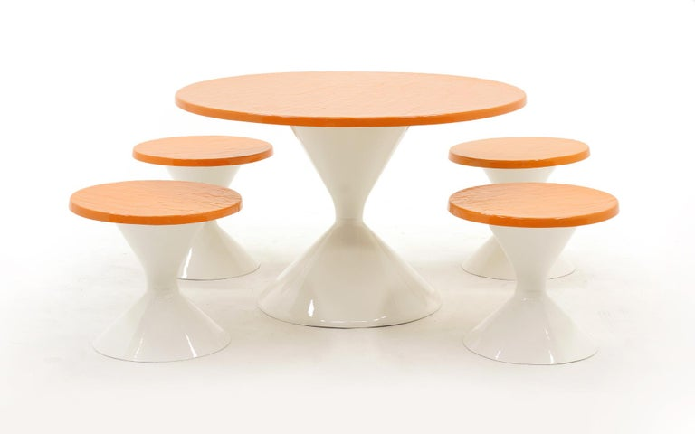Patio round table and four seats / chairs / stools with white tulip bases and an orange faux slate top. Mod, cool, fun set. Professionally repainted with a white conversion varnish so it will be super durable outside. There are a few imperfections
